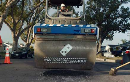 Here's Why Domino's Pizza is Fixing Potholes on Roads Across the Country